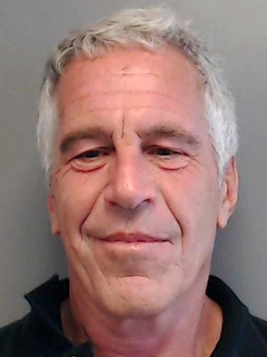 Jeffrey Epstein poses for a sex offender mugshot
