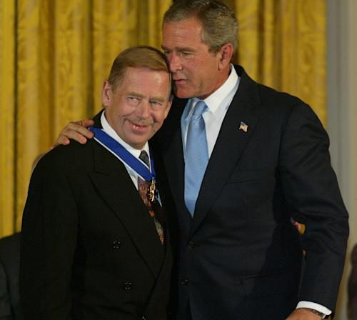 FILE - President Bush embraces Vaclav Havel, former president of the Czech Republic, after presenting him with the Presidential Medal of Freedom in the East Room of the White House in this July 23, 2003 file photo. The Presidential Medal of Freedom is the highest civilian award of the U.S. government. Havel, the dissident playwright who wove theater into politics to peacefully bring down communism in Czechoslovakia and become a hero of the epic struggle that ended the Cold War, died Sunday Dec. 18, 2011 in Prague. He was 75. (AP Photo/Charles Dharapak, File)