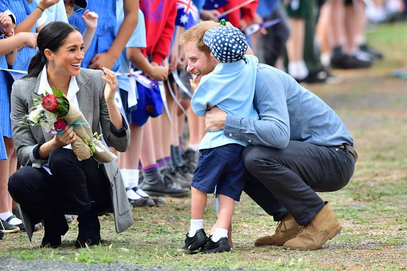Prince Harry also gives Luke a big hug. Photo: Getty, meghan markle prince harry dubbo, meghan markle prince harry australia, meghan markle serena williams jacket, meghan markle pregnant