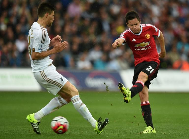 Manchester United's Ander Herrera (R) takes an unsuccessful shot as Swansea City's Federico Fernandez defends during their Premier League match at The Liberty Stadium in Swansea on August 30, 2015