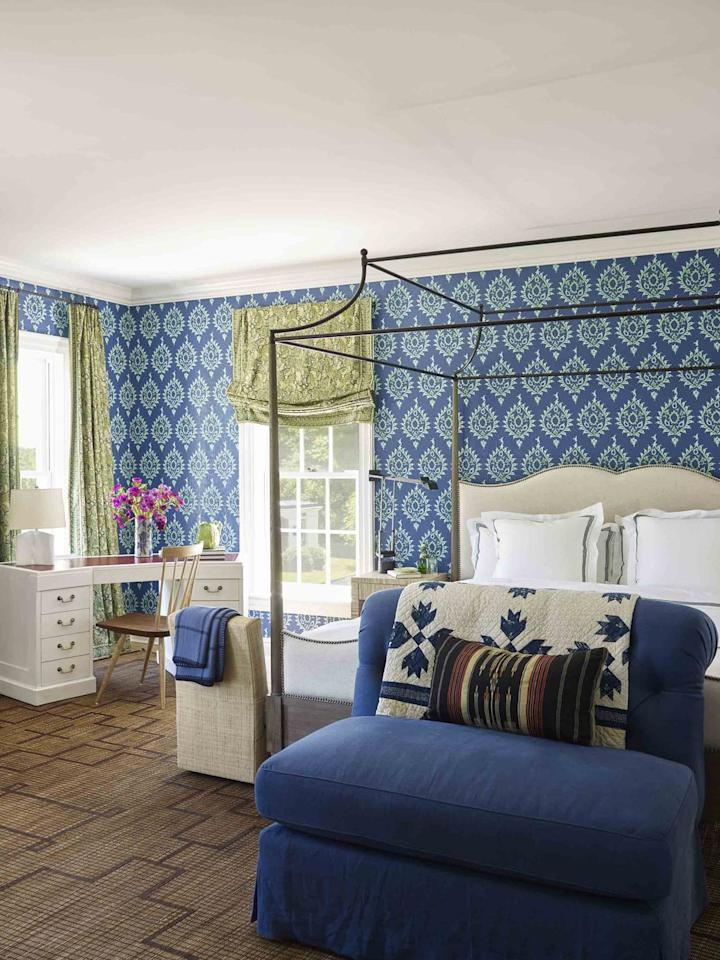 """<p>David Netto prevents <a href=""""https://www.veranda.com/decorating-ideas/house-tours/a32721440/david-netto-connecticut-house/"""" target=""""_blank"""">this traditional Connecticut</a> bedroom from sinking into boredom thanks to some fun vintage finds, like the Morrocan Tuareg mat. Bold, heavy-patterned wallpaper rounds out the room and allows the simple, sophisticated furnishings to shine.</p>"""