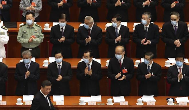 Delegates applaud as President Xi Jinping arrives for the opening session of the National People's Congress. Photo: AP