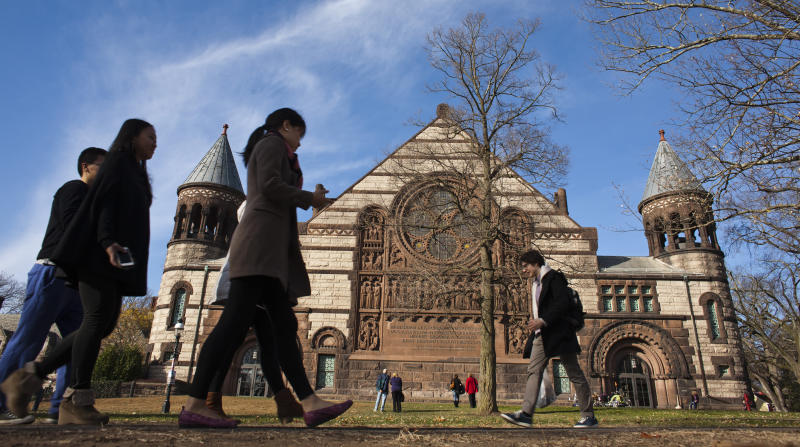 People walk around the Princeton University campus in New Jersey, November 16, 2013. A meningitis vaccine approved for use in Europe and Australia but not in the United States can be imported to try to stop an outbreak of the disease at Princeton University in New Jersey, federal health officials said. The Food and Drug Administration agreed this week to the importation of the vaccine, Bexsero, for potential use on the Ivy League campus, Barbara Reynolds, a spokeswoman for the Centers for Disease Control and Prevention, said on Saturday. REUTERS/Eduardo Munoz (UNITED STATES - Tags: SOCIETY EDUCATION HEALTH)