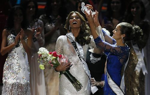 Miss Universe 2012 Olivia Culpo, from the United States, right, places the crown on Miss Venezuela Gabriela Isler during the 2013 Miss Universe pageant in Moscow, Russia, Saturday, Nov. 9, 2013. (AP Photo/Pavel Golovkin)