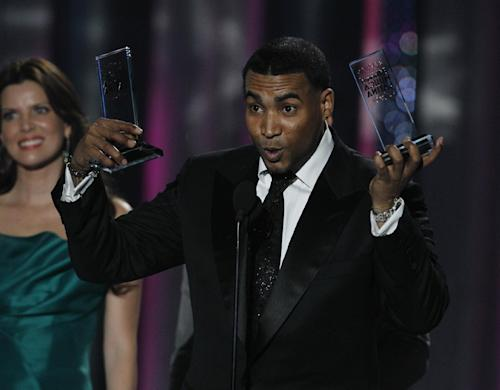 Singer Don Omar lifts awards for Latin Pop Song of the Year and Latin Rhythm Song of the Year, Solo artist, during the Latin Billboard Awards in Coral Gables, Fla., Thursday April 26, 2012. (AP Photo/Lynne Sladky)