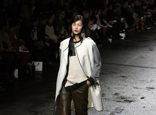 The Phillip Lim Fall 2013 collection is modeled during Fashion Week in New York on Monday, Feb. 11, 2013. (AP Photo/Lisa Tolin)