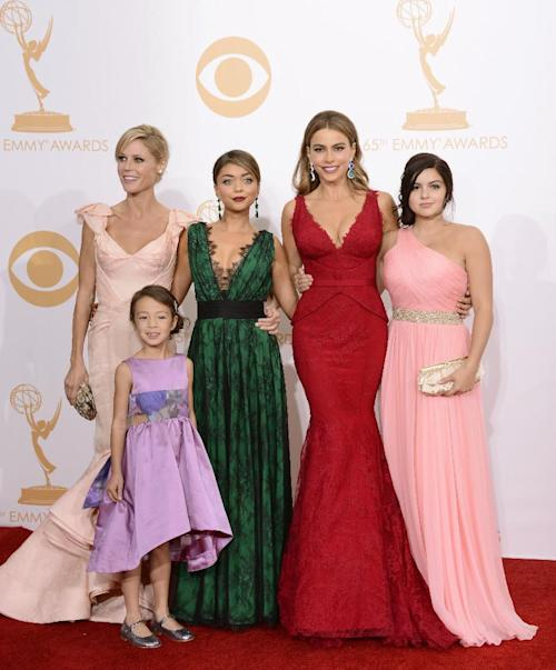 "Julie Bowen, from left, Aubrey Anderson-Emmons, Sarah Hyland, Sofia Vergara and Ariel Winter, winners of outstanding comedy series for ""Modern Family,"" pose backstage at the 65th Primetime Emmy Awards at Nokia Theatre on Sunday Sept. 22, 2013, in Los Angeles. (Photo by Dan Steinberg/Invision/AP)"