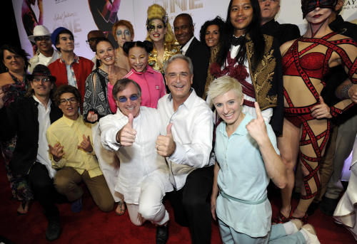 "Cirque du Soleil President and CEO Daniel Lamarre, left center, and Mandalay Bay Resort and Casino President and COO Chuck Bowling, center, arrive with cast members at the world premiere of ""Michael Jackson ONE"" at THEhotel at Mandalay Bay Resort and Casino on Saturday, June 29, 2013 in Las Vegas. (Photo by David Becker/Invision/AP)"