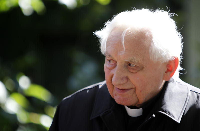 FILE - In this Thursday, Sept. 16, 2010 file photo, Georg Ratzinger attends a ceremony to hand over the keys of his house in Pentling near Regensburg, Germany. The Rev. Georg Ratzinger, the older brother of Emeritus Pope Benedict XVI, who earned renown in his own right as a director of an acclaimed German boys' choir, has died at age 96. The Regensburg diocese in Bavaria, where Ratzinger lived, said in a statement on his website that he died on Wednesday, July 1, 2020. (AP Photo/Matthias Schrader, File)