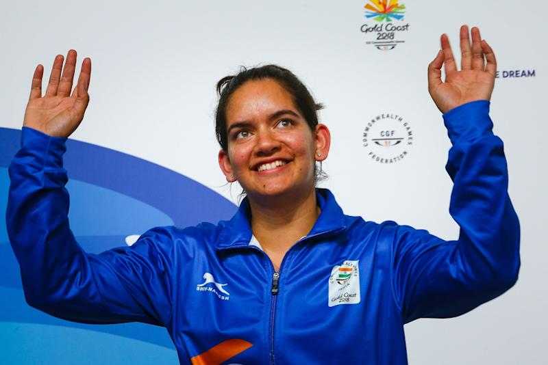 India's silver medallist Anjum Moudgil, celebrates on the podium during the medals ceremony after winning in the women's 50m rifle 3 positions shooting finals of the 2018 Gold Coast Commonwealth Games at the Belmont Shooting Complex in Brisbane on April 13, 2018. / AFP PHOTO / Patrick HAMILTON (Photo credit should read PATRICK HAMILTON/AFP via Getty Images)