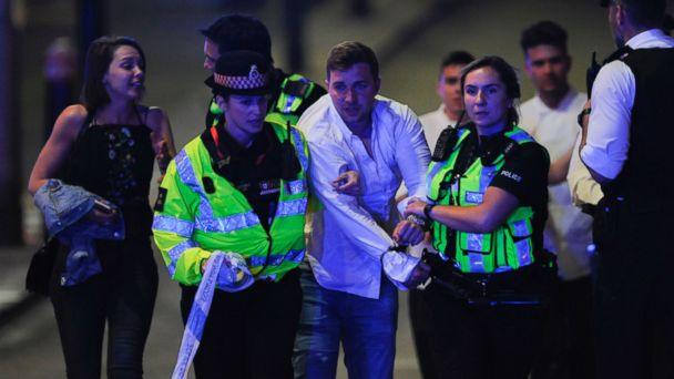 PHOTO: Police escort a member of public as they clear the scene of a terror attack on London Bridge in central London on June 3, 2017. (Daniel Sorabji/AFP/Getty Images)