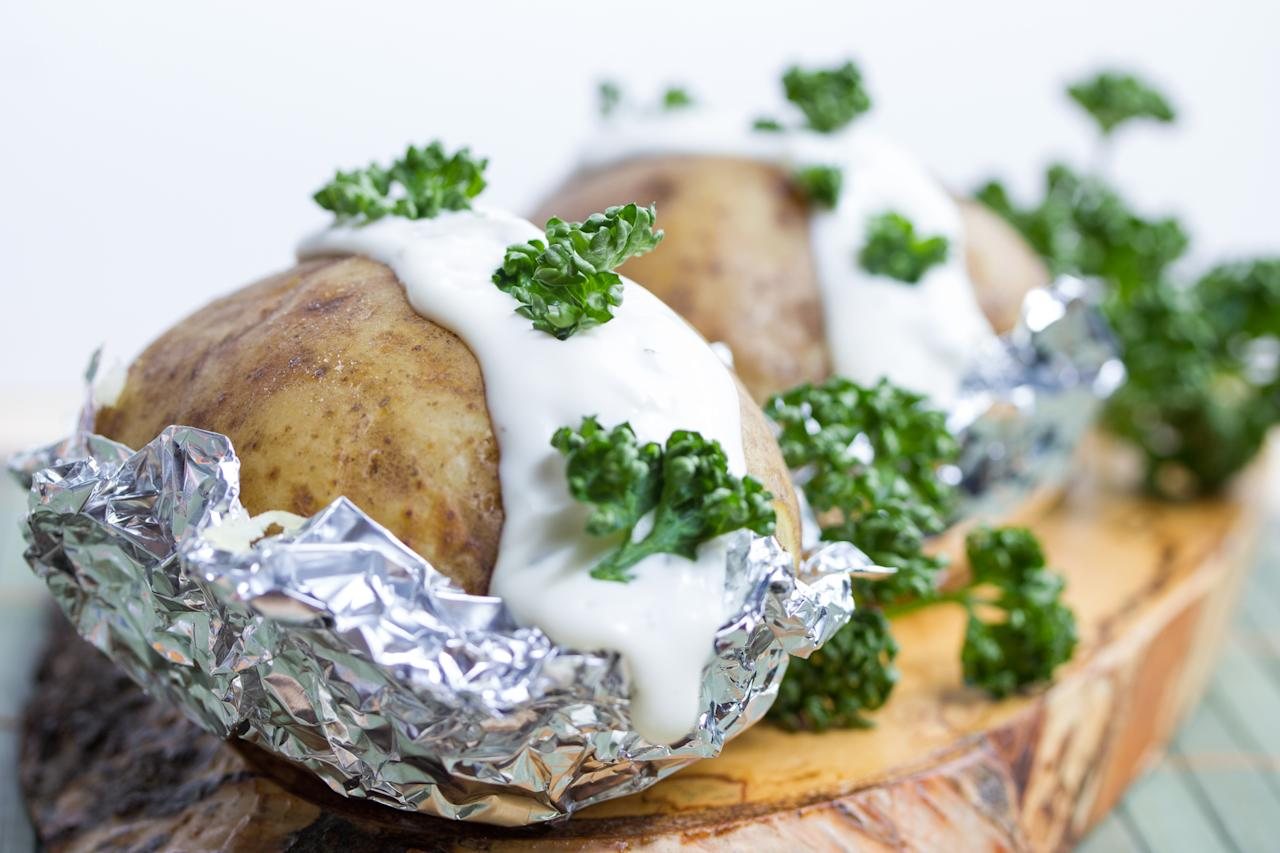 "<p>These silver-wrapped spuds can produce the botulinum toxin, which leads to botulism. ""Botulism can kill you,"" Richards said. ""Don't leave food out at room temperature because it can become contaminated afterward."" Duane Mellor, Accredited Practising Dietitian and spokesperson for the Dietitians Association of Australia, told SBS that a bacteria called Clostridium botulinum may form if potatoes aren't stored in the fridge after cooking. ""It particularly likes to grow in low-oxygen environments, like the one created when you wrap a potato in foil, cook it, and then leave it in the foil, and can cause a potentially life-threatening illness,"" she said. However, she claified that you're still all good to cook the potatoes in foil, as long as remove it before you put any leftover in the fridge. </p>"