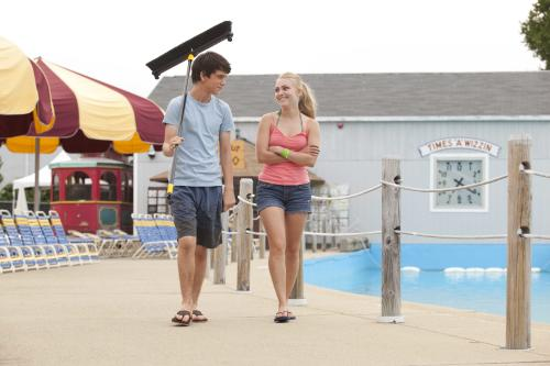"""This film publicity image released by Fox Searchlight shows Liam James , left, and AnnaSophia Robb in a scene from """"The Way Way Back."""" (AP Photo/Fox Searchlight, Claire Folger)"""