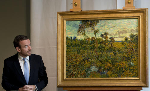 "CAPTION CORRECTION, CORRECTS SPELLING OF SURNAME TO REFLECT AP STYLE - Van Gogh Museum director Axel Rueger, left, looks at ""Sunset at Montmajour"" after unveiling the painting by Dutch painter Voncent van Gogh during a press conference at the museum in Amsterdam, Netherlands, Monday Sept. 9, 2013. The museum has identified the long-lost painting which was painted by the Dutch mater in 1888, the discovery is the first full size canvas that has been found since 1928 and will be on display from Sept. 24. (AP Photo/Peter Dejong)"
