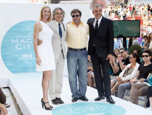 "This publicity image released by Starz shows the cast of the series ""Magic City"", from left, Kelly Lynch, show creator, Mitch Glazer, Michael Rispoli, and Danny Huston in Times Square on New York, June 12, 2013 to promote the season two premiere airing Friday, June 14 at 9 p.m. on Starz. (AP Photo/Starz, Stuart Ramson)"