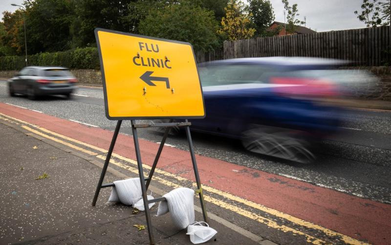 A sign directs drivers to a drive-in flu clinic in Edinburgh - PA/Jane Barlow