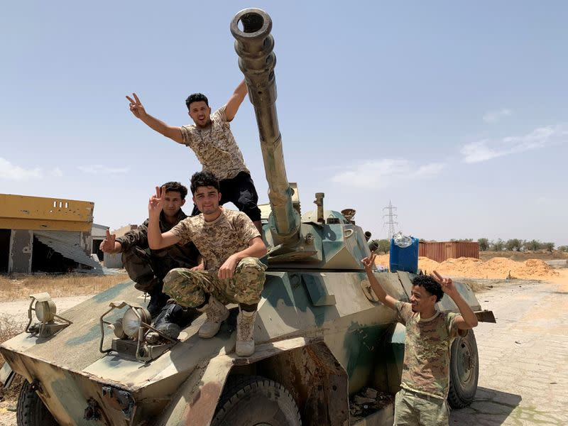 FILE PHOTO: Fighters loyal to Libya's internationally recognised government celebrate after regaining control over Tripoli