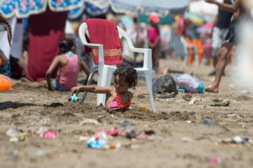 A child plays on the beach in Rabat on July 12, 2018