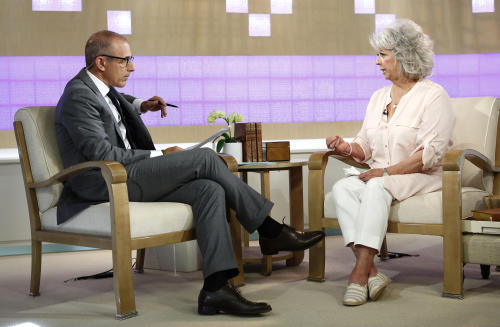 "In this publicity image released by NBC, celebrity chef Paula Deen appears on NBC News' ""Today"" show, with host Matt Lauer, Wednesday, June 26, 2013 in New York. Deen dissolved into tears during a ""Today"" show interview Wednesday about her admission that she used a racial slur in the past. The celebrity chef, who had backed out of a ""Today"" interview last Friday, said she was not a racist and was heartbroken by the controversy that began with her own deposition in a lawsuit. Deen has been dropped by the Food Network and as a celebrity endorser by Smithfield Foods. (AP Photo/NBC, Peter Kramer)"