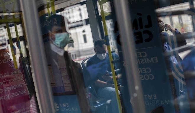 Commuters on a bus in Madrid, Spain, on Sunday. Photo: AP