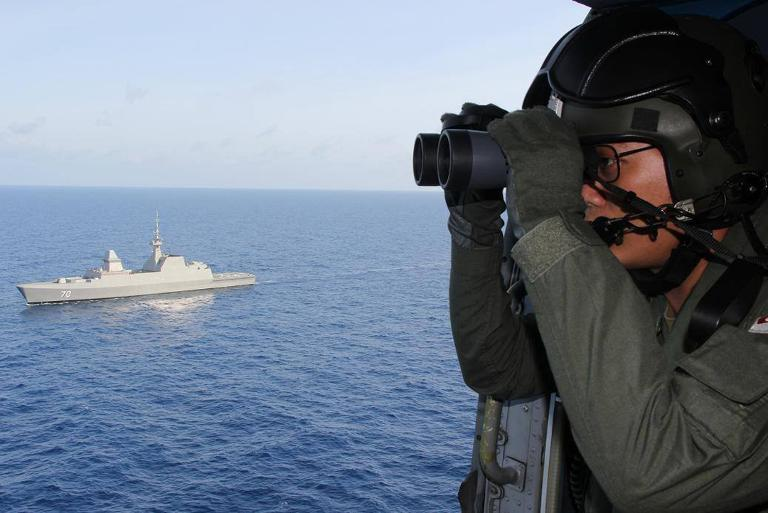 A Singapore Navy photo shows personnel participating in the search and rescue operations in the South China Sea for the missing Malaysia Airlines flight MH370, on March 13, 2014