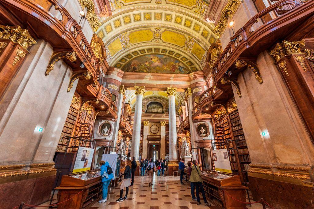 "<p>If you're searching for a book to get lost in, it only makes sense to channel your inner Matilda and head to the nearest <a href=""https://www.housebeautiful.com/lifestyle/g32258176/libraries-tour-virtually-prague-morgan-nypl/"">library</a>, and hopefully, you'll be left with a feeling of inspiration beyond what you read. At<em> House Beautiful, </em>we are partial to <a href=""https://www.housebeautiful.com/room-decorating/home-library-office/"">libraries</a> that also serve up a serious dose of design inspiration.—and lucky for us, there are many around the world. Whether it's the remarkable architecture of the Rampur Raza Library in India—which features a combination of Hindu, Victorian Gothic, and Islamic elements—or the heavenly ceiling of the Rose Main Reading Room at the New York Public Library, you might even forget that you're standing in a <a href=""https://www.housebeautiful.com/room-decorating/home-library-office/g696/designer-libraries/"">library</a> and not a palace. After all, the right books will transport you to places as awe-inspiring as these libraries, no matter your location. </p>"