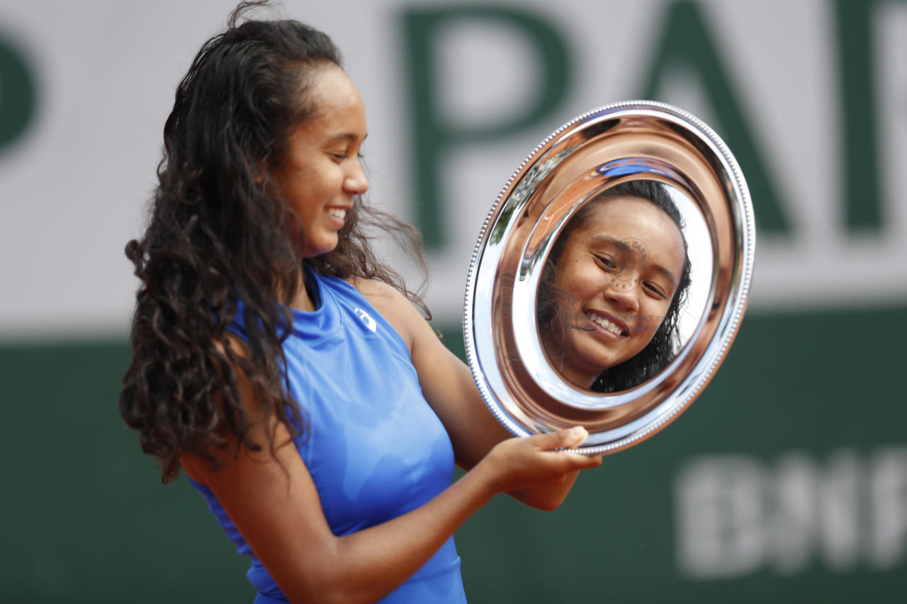 Canada's Leylah Annie Fernandez holds the trophy after winning the junior women's final match of the French Open tennis tournament against Emma Navarro of the U.S. in two sets, 6-3, 6-2, at the Roland Garros stadium in Paris, Saturday, June 8, 2019. (AP Photo/Jean-Francois Badias)