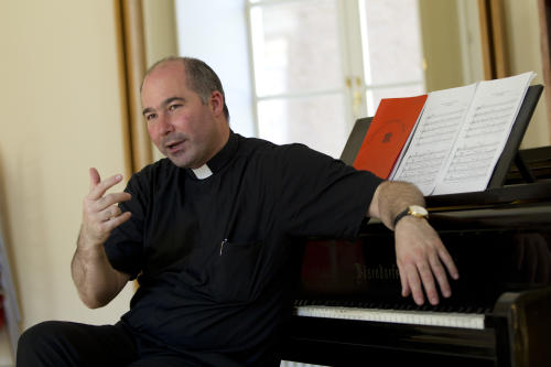 The director of the Sistine Chapel Choir, Monsignor Massimo Paolombella talks during an interview with The Associated Press, in Rome, Monday, June 25, 2012. The Westminster Abbey Choir, the world-renown chorus which last year performed at the wedding of Prince William and Kate Middleton, will join the Sistine singers at a special papal Mass on Friday in St. Peter's Basilica, a historic event seen as a perfect symbol of Christian harmony _ after centuries of discord. It's the first time in its 500-plus year history that the pope's personal choir will be accompanied by another chorus, let alone one that comes from the breakaway Anglican Church. (AP Photo/Andrew Medichini)