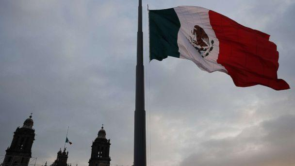 PHOTO: The Mexican flag flying at half mast in the Constitution Square to commemorate the 32nd anniversary of the 8.0 earthquake that occurred on September 19, 1985, in Mexico City, Mexico. (Jose Mendez/EPA)