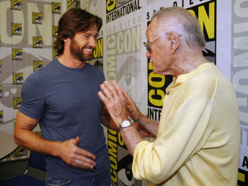 """FILE - In this July 24, 2008 file photo, actor Hugh Jackman, left, talks to legendary comic book creator Stan Lee, right, after an interview at the Comic-Con 2008 convention in San Diego. Attending Comic-Con is often a once-in-a-lifetime opportunity for many con-goers, but it's just another summertime destination for the likes of """"The Wolverine"""" star Jackman, geeky funnyman Patton Oswalt and """"The Amazing Spider-Man"""" sequel writers Alex Kurtzman and Roberto Orci. (AP Photo/Denis Poroy)"""
