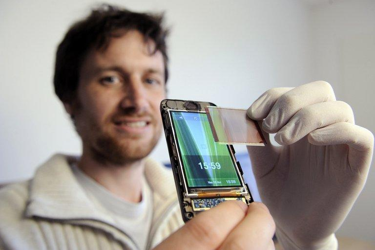 Company head Ludovic Deblois demonstrates Wysips's photovoltaic film in Lambesc, France in 2011. Wysips, a startup based in Aix-en-Provence, southern France, has developed a photovoltaic film which can be built seamlessly into a mobile phone screen and deliver the joy of life to a flat battery
