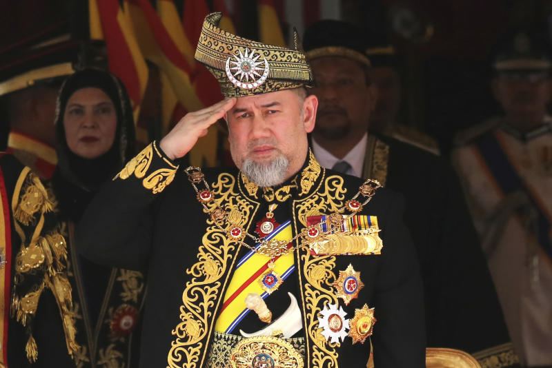 FILE - In this July 17, 2018, file photo, Malaysian King Sultan Muhammad V salutes during the national anthem at the opening of the 14th parliament session at the Parliament house in Kuala Lumpur, Malaysia. The central Malaysian state of Pahang is getting a new sultan who is tipped to become the country's next king under a unique rotating monarchy system. The Conference of Rulers has said it will pick a new king among nine hereditary state rulers on Jan. 24 following the sudden abdication of Sultan Muhammad V. No reasons were given for the Jan. 6 abdication, which came after Sultan Muhammad V reportedly married a former Russian beauty queen. (AP Photo/Yam G-Jun, File)