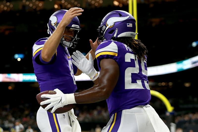 Alexander Mattison of the Minnesota Vikings celebrates with Kirk Cousins after scoring a touchdown during the first quarter against the New Orleans Saints (Getty Images)