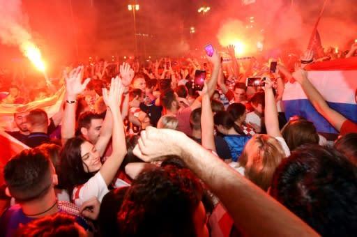 Croatia fans in Zagreb's main square celebrate their World Cup semi-final win over Russia