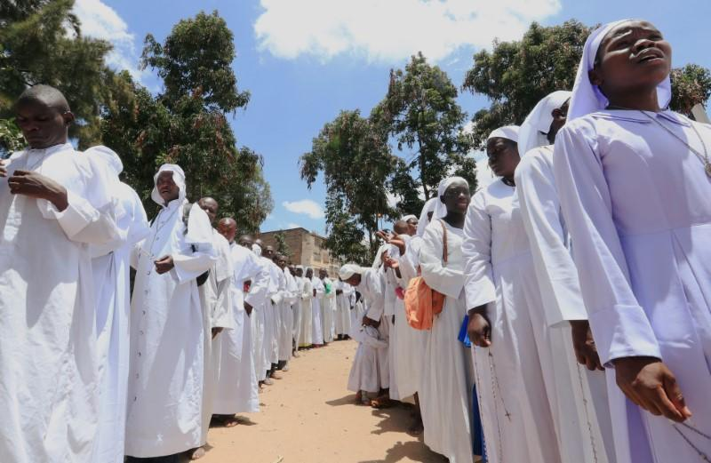Faithful participate in a holy procession after celebrating a mass, amid concerns about the spread of coronavirus disease (COVID-19) at the St. Joanes, Legio Maria African Mission Church within Fort Jesus in Kibera slums of Nairobi