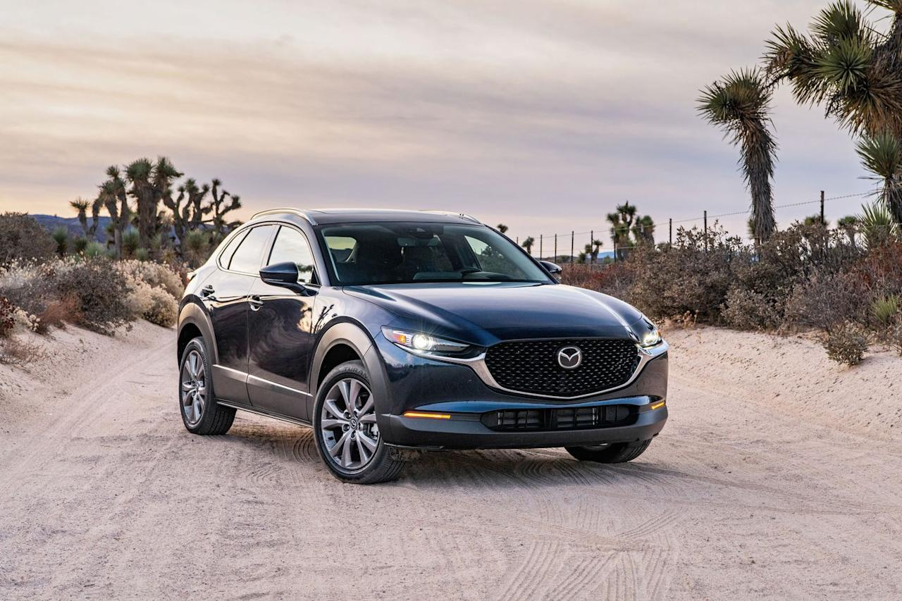 """<p>Slotting into the Mazda SUV lineup in the narrow space between the <a href=""""https://www.caranddriver.com/mazda/cx-3"""" target=""""_blank"""">subcompact CX-3</a> and the <a href=""""https://www.caranddriver.com/mazda/cx-5"""" target=""""_blank"""">compact CX-5</a> is the new—and curiously named—CX-30. Mazda's designers gave it a more severely forward-canted rear window and chunkier black-plastic body cladding to help differentiate the 2020 CX-30 from its other crossover siblings. The CX-30 comes standard with impressive technology, both in terms of connectivity and driver-assistance features. Equipped with the same perky and responsive engine as the <a href=""""https://www.caranddriver.com/mazda/mazda-3"""" target=""""_blank"""">Mazda 3</a>, the CX-30 oozes that enthusiast appeal for which <a href=""""https://www.caranddriver.com/mazda"""" target=""""_blank"""">Mazda</a> is famous.</p><p><a class=""""body-btn-link"""" href=""""https://www.caranddriver.com/mazda/cx-30"""" target=""""_blank"""">Review, Pricing, and Specs</a></p>"""