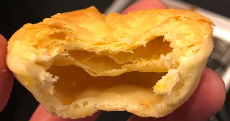 An Adelaide Crows fan claims to have eaten a Balfours Bakery meat pie with no filling in it.