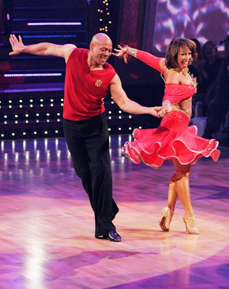 Maurice Greene and Cheryl Burke perform a dance on the seventh season of Dancing with the Stars.