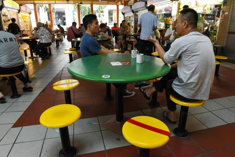Singaporeans could be jailed for up to six months if they intentionally stand close to someone else