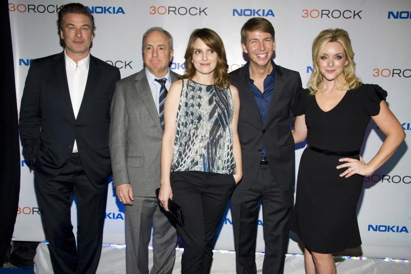 """FILE - In this Dec. 20, 2012 file photo, Alec Baldwin, from left, Lorne Michaels, Tina Fey, Jack McBrayer and Jane Krakowski attend the """"30 Rock"""" farewell wrap party in New York. At the request of co-creator Tina Fey, four episodes of the comedy """"30 Rock"""" are being removed from circulation because they featured characters performing in blackface. The series aired on NBC from 2006 to 2013, but episodes are still being shown in television syndication and on streaming services including Hulu, Amazon Prime, iTunes and Peacock. (Photo by Charles Sykes/Invision/AP, File)"""