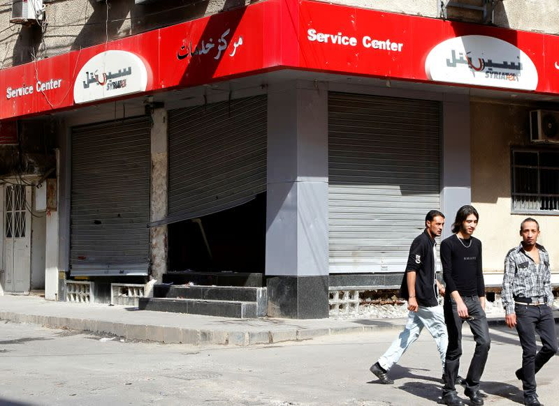 Syrian tycoon says government ordered him to step down from mobile operator