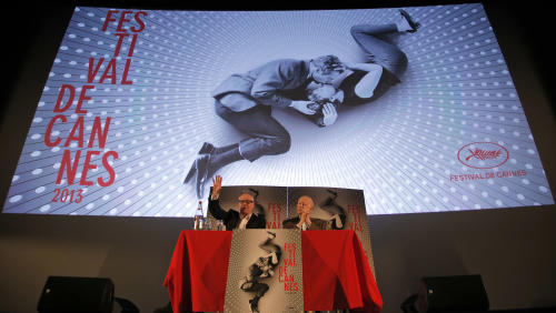 President of the Cannes Film Festival Gilles Jacob, right, and artistic Director Thierry Fremaux, attend a news conference to announce this 2013 festival line up in front of the Cannes International Film Festival poster for the upcoming 66th edition featuring U.S. actors Paul Newman and Joanne Woodward, in Paris, Thursday April 18, 2013. The festival will run from May 15 to May 26, 2013. (AP Photo/Francois Mori)