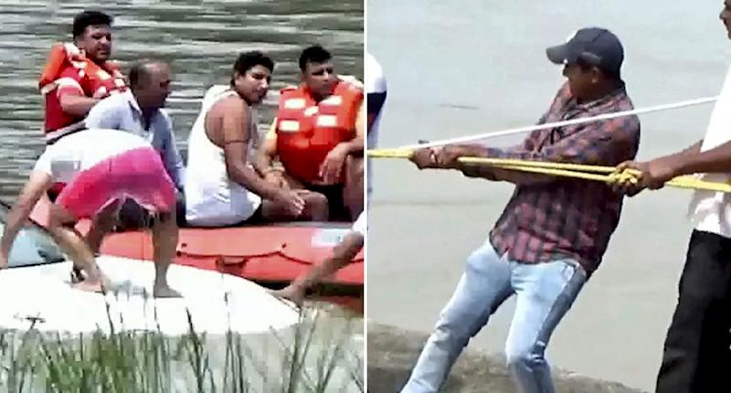 A group of men pull a BMW from a river in Yamunanagar in India's north. It's alleged the owner sank it because he was angry he didn't receive a Jaguar for his birthday from his parents.