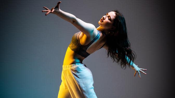 Ilustrasi menari (Foto: unsplash.com/Morgan Petroski)