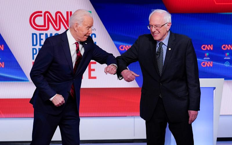 Mr Biden has tried to appeal to left-wing supporters of Mr Sanders - AP