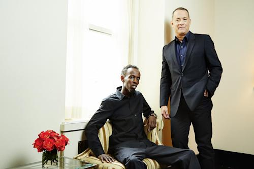 "This Sept. 27, 2013 photo shows actors Tom Hanks, right, and Barkhad Abdi, of ""Captain Phillips,"" in New York. The film, about the 2009 hijacking of the US-flagged MV Maersk Alabama by Somali pirates, opens Oct. 11. (Photo by Dan Hallman/Invision/AP)"