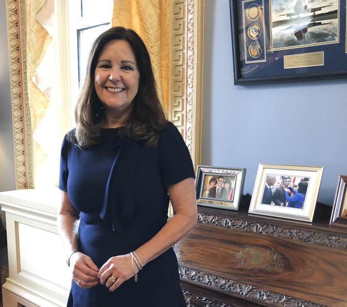 FILE- In this Jan. 31, 2020 file photo, Karen Pence, wife of Vice President Mike Pence, poses for a photograph in her office in the Eisenhower Executive Office Building, on the White House campus in Washington.  Pence says it's OK to not be OK during the coronavirus pandemic.  While Vice President Mike Pence runs the White House coronavirus task force, his wife is leading a parallel effort to help people deal with anxiety and other unsettling emotions brought on by the pandemic. (AP Photo/Darlene Superville)