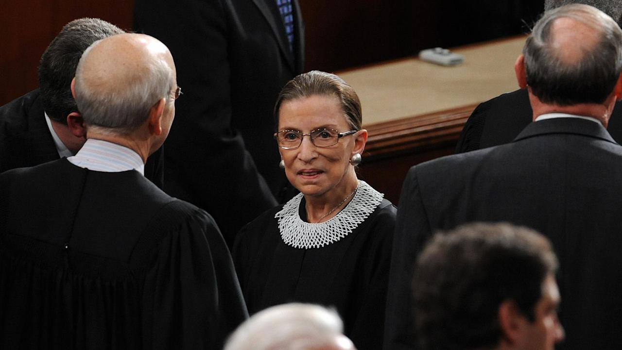 """<p>Though she had many collars in her closet, Ginsburg told Couric that a white crochet collar—which she acquired in Cape Town, South Africa—was her clear """"favorite."""" Sleek and simple, it made appearances to a number of events, including President Barack Obama's State of the Union in 2012, her 20th anniversary on the bench in 2013, and a slew of photo sessions with her colleagues. </p>"""