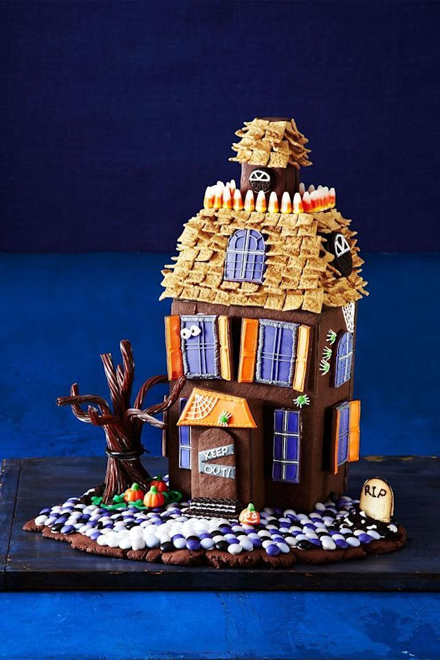 """<p>Go big and bold with an edible haunted house. The frightening and delicious combination of chocolate cookie walls and candy decorations is sure to be a conversation starter. </p><p><em><a href=""""https://www.goodhousekeeping.com/holidays/halloween-ideas/g1659/halloween-haunted-cookie-house/"""" target=""""_blank"""">Get the tutorial >></a></em><br></p>"""