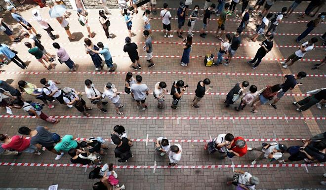 People queue up to vote on Sunday in an opposition camp primary designed to winnow down their field of candidates for September's Legco elections. Photo: Felix Wong